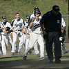 Peabody: Peabody High School baseball team reacts after Stephen Girolamo stole home.  The Tanners won 6-5 over Malden Catholic after thirteen innings of play.  photo by Mark Teiwes / Salem News