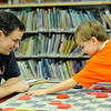 Hamilton: 7-year-old Scott Daley of Hamilton puts the finishing touches on a checker game, beating his Mike his dad.  photo by Mark Teiwes / Salem News