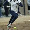 Beverly: Endicott College center fielder Ashley Wright gets a base hit off a bunt.  photo by Mark Teiwes / Salem News