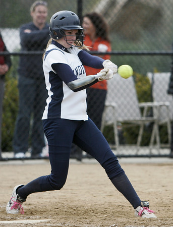 Beverly: Endicott College player Alexandra Moise makes contact at bat against Roger Williams.  photo by Mark Teiwes / Salem News