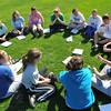 Danvers: Danvers High softball players work on team bonding with a circle game during practice. Mark Teiwes / Salem News