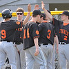 Beverly: The Beverly High School baseball team celebrates a run during a 6-4 win over Gloucester. photo by Mark Teiwes / Salem News
