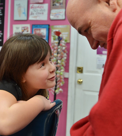 Danvers: Wylinn Palmisano, 6, jokes with her father John, the owner of Goodies Ice Cream.  photo by Mark Teiwes / Salem News