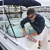 Beverly: The Navigator Club dockmaster Chris Haight at Beverly Port Marina takes care of the hassle of owning a boat.  Members pay a yearly fee and are able to use the club's boats.  photo by Mark Teiwes / Salem News