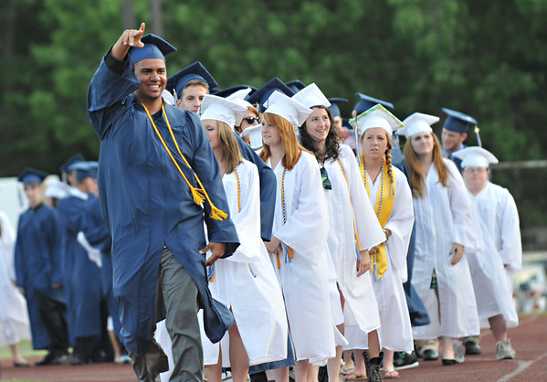 Peabody: Jefry Mercedes reacts to cheers from the crowd as his name is called to receive his diploma.   photo by Mark Teiwes / Salem News