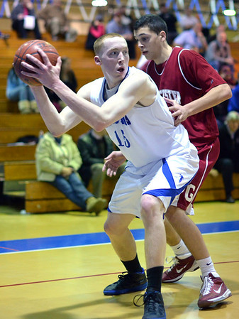 Danvers:  Danvers captain Sean Mahegan looks for a pass during the team's 50-46 win over Gloucester.  photo by Mark Teiwes / Salem News
