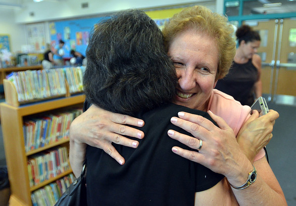 Salem: Marsh Feffer, right, a preschool teacher at the Salem Early Childhood Center is congratulated by retired teacher Lucille Ouellette of Beverly after receiving the Margaret Voss Teacher Recognition Award.  photo by Mark Teiwes / Salem News