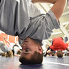 Danvers:  13-year-old Stephen Serino of Beverly stretches his neck at the beginning of the North Shore Youth Wrestling clinic.  photo by Mark Teiwes / Salem News
