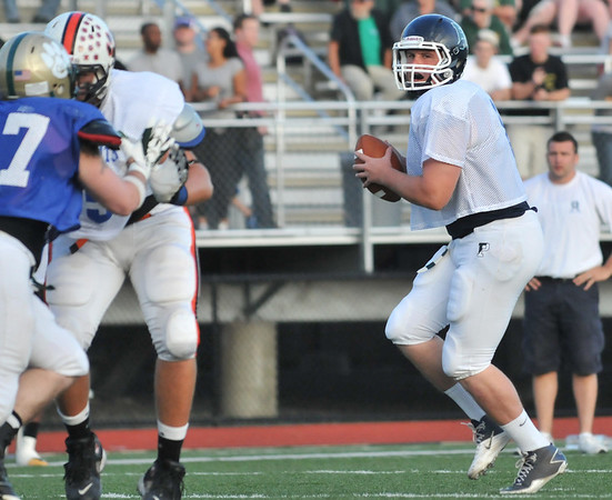Lynn: Pingree quarterback Brendan Oliver looks for a pass at the 50th annual Agganis All-Star Football Classic .  photo by Mark Teiwes  / Salem News