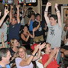 Beverly: US soccer fans cheer after Landon Donovan scores a penalty kick to tie Ghana.  The US went on to lose in overtime.  photo by Mark Teiwes / Salem News