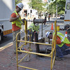 Salem: Crew work to restore power on Essex Street after a series of manhole explosions Saturday night. photo by Mark Teiwes / Salem News