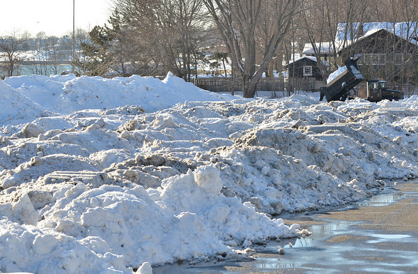 Beverly: A truck dumps snow into the snow-filled parking lot at Lynch Park.   photo by Mark Teiwes  / Salem News
