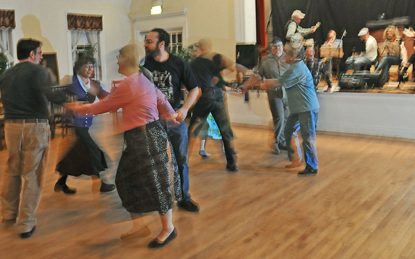 Salem: Dancers swing and spin during the Salem First Saturday Contra Dance at Tabernacle Church photo by Mark Teiwes / Salem News
