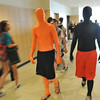Beverly: Cam Jones, left, and Jake Levine, walk the halls of Beverly High School.  The students raise school spirit before a football game and run around with signs during games encouraging fans to cheer.     photo by Mark Teiwes / Salem News
