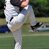 Peabody: Bishop Fenwich's pitcher winds up for a pitch. photo by Mark Teiwes / Salem News