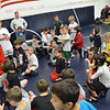 Danvers:  Masco Youth Wrestling coach Todd Darling, left, leads a wrestling clinic.  Over 100 participants from pre-K to 8th grade are in the program.   photo by Mark Teiwes / Salem News