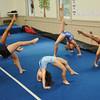 Danvers: Yellow Jacket gymnastics practice the bridge.
