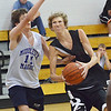 Danvers: St. John's Prep player Andrew Hall, left, defends Ipswich's Sam Hurst as he goes up strong to the hoop in a North Shore summer league playoff game.  photo by Mark Teiwes / Salem News.