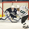 Hamilton: Pingree goalie Lindsay O'Connell makes a save from a shot by Hebron Academy's Taylor Teixeira.  photo by Mark Teiwes / Salem News