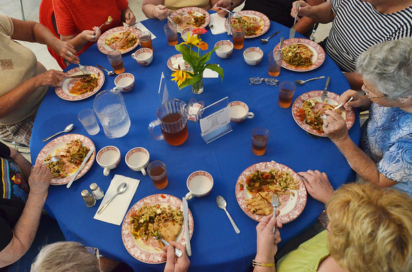 "Ipswich:  Nine dinners enjoy a meal and each other's company at the Ipswich ""Dinner Bell"" program.   photo by Mark Teiwes /  Salem News"