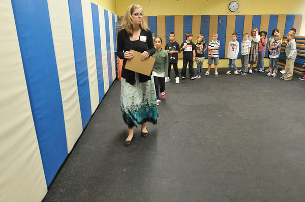 Salem: Saltonstall School 3rd and 4th grade teacher Allison Benoit leads a tour of the gym where they will have activities if there is snow or rain.  The plan is to be mostly outside for recreation activities.  photo by Mark Teiwes  / Salem News