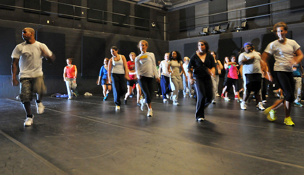 Beverly: Devin Woolridge, left, leads an Urban dance workshop at Endicott College.  He also helped choreograph dances in the new Xbox game Dance Central.   photo by Mark Teiwes / Salem News