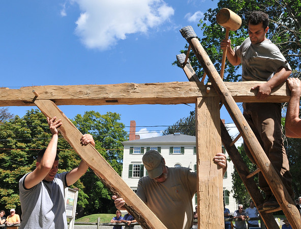 Ipswich:  Matt Diana of Newton hammers with a traditional tool,  building with materials and construction methods of the First Period (1625–1725).   photo by Mark Teiwes / Salem News