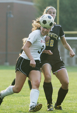 Marblehead:  Marblehead's Lindsay Cohen, left, battles with Bishop Fenwick's Lauren Moulton in a 3-3 tie.  photo by Mark Teiwes / Salem News