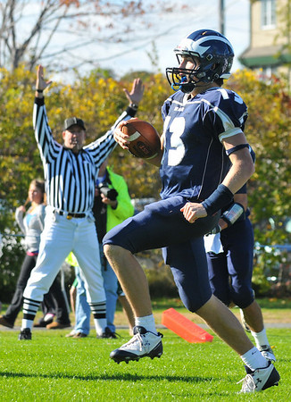 Swampscott: Swampscott quarterback keeps the ball to run for a touchdown in the first quarter.  photo by Mark Teiwes / Salem News