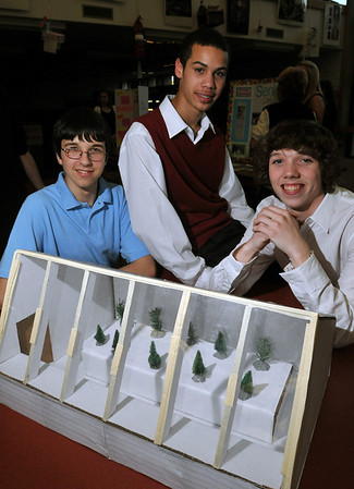 Salem: Salem High School freshman, Greg Cook, left, sophomore Alvin Rodriguez and sophomore Nolan Markham exhibit a four season green house they designed in engineering class.  They hope to build a full size version.    photo by Mark Teiwes / Salem News