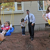 Peabody: Mayoral candidate Ted Bettencourt plays with his family in their backyard.  photo by Mark Teiwes / Salem News