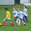 Hamilton:  A Yellow Butterflies player dirbbles away from the the Blue Dolphins in a Hamilton Wenham youth soccer game.  photo by Mark Teiwes / Salem News