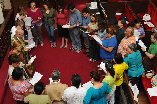 Salem:  The St. Peter's Episcopal Church spanish speaking congregation commissions four people to be part of a group going to Arizona with Promise Arizona to register Hispanic voters. photo by Mark Teiwes / Salem News