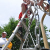 Salem: The Parents United of Salem has spent three years raising funds to build a playground on Salem Common.  Josh Lausier of Salem helps install the swing set with his boy scout troop.