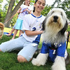 Danvers: Sydnie Difranco and her bearded collie Drake both wear soccer jerseys at a dog show raising money for Strays in Need.  photo by Mark Teiwes / Salem News
