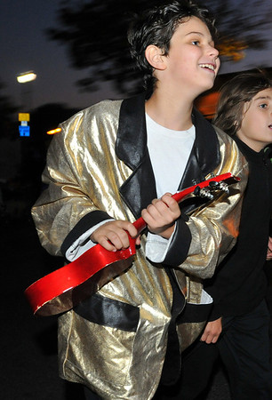 Salem:  Jacob Barz-Snell of Salem, 11, struts tdown the street as Elvis. photo by Mark Teiwes / Salem News