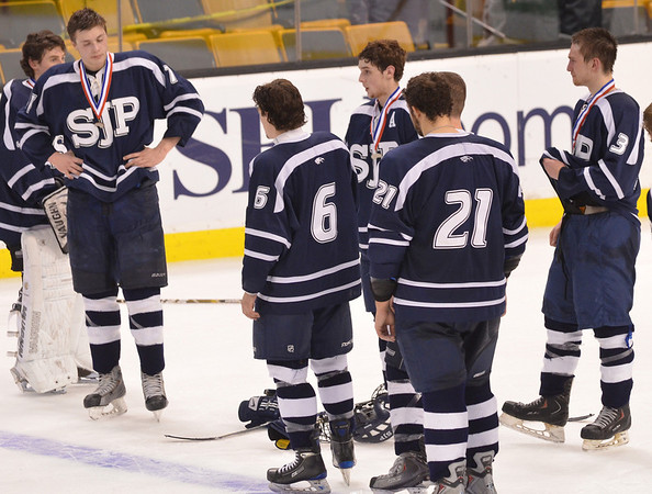 Boston: St. John's Prep hockey team shows their disappointment after fighting hard and losing 3-4 in overtime to Malden Catholic in the division 1A state final.   photo by Mark Teiwes / Salem News