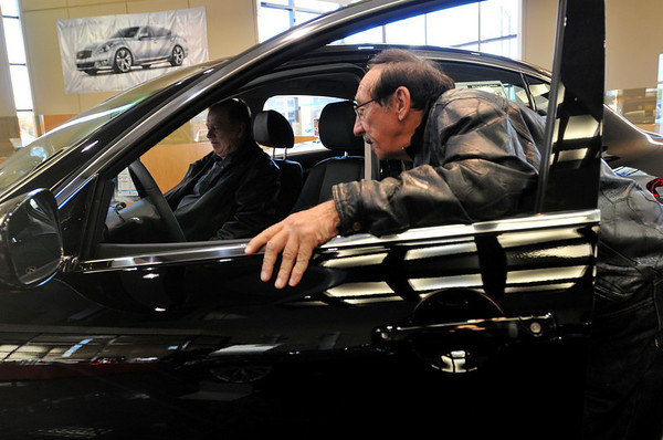 Danvers: Carl DeQuattro, right and his friend Carl Johnson take a look inside the new G25X model.    photo by Mark Teiwes / Salem News