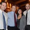"Danvers: MassPay organized the first ""Fed Up With Cancer"" event at Danversport Yacht club raising money for Mass General/North Shore Canter Center.  From left, Kevin Mason,  Jason Maxwell president of MassPay and his wife Jeannie, and Joshua Soroko.  photo by Mark Teiwes / Salem News"