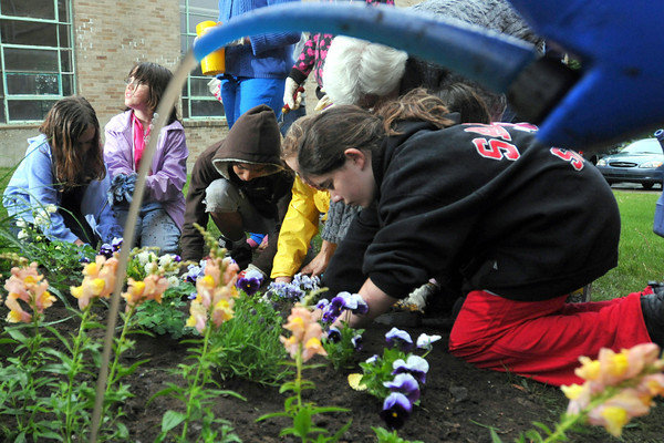 Peabody: Girl Scout Juniors troup 60361 plants a tranquility garden at St. Thomas Church. / Photo by Mark Teiwes / Salem News