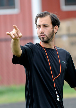 Marblehead:  Marblehead boys varsity soccer team coach Darren Benedick calls out directions during practice.  photo by Mark Teiwes / Salem News