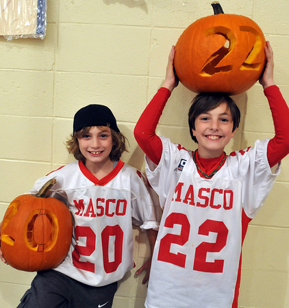 Middleton: Dylan Ursin, 10, left, and Dash Crevoiserat, 10, show off the pumpkins they carved to match their Masco youth football jerseys.    photo by Mark Teiwes / Salem News