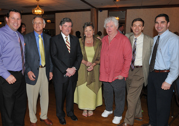 Salem:  Bentley School Principal Nancy Pelletier, center, celebrated her retirement at a party with friends, family, and colleges.  From left, Witchcraft Heights Principal Mark Higgins, Assistant Superintendent Steven O'Brien, Superintendent William Cameron, Nancy Pelletier,  Collins Middle School Principal Mary Manning, Horace Mann Laboratory School Principal Kevin Andrews, and Salem High School Principal David Angeramo.  photo by Mark Teiwes / Salem News
