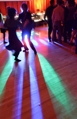 Salem: Syd Rhodes, left, and Jaiden Deschene hit the dance floor during the Salem High School Junior/Senior Catillion.  photo by Mark Teiwes / Salem News
