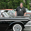 Salem:  Eric Anderson of Marblehead stands behind his 1959 Edsel  at the Hawthorn Hotel parking lot for a Edsel Convention.  HIs 6-year-old daughter enjoys riding around town.  photo by Mark Teiwes / Salem News