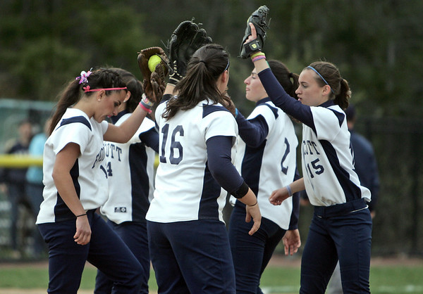 Beverly: Endicott College infielders come together after a key out against Roger Williams in the NCAA conference tournament.  photo by Mark Teiwes / Salem News