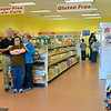 Danvers: Pat and Carol Sheehan stand with their son John inside their store, My Low Carb Life. photo by Mark Teiwes / Salem News