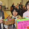 Beverly: Yoko Aoki, left, her son Kai Marcos and Kai Marcos, North Beverly Elementary School fifth graders.   Yoko helped make paper cranes to give to people who made donations for relief efforts in Japan.  They have family in Japan that are effected by the disaster.  photo by Mark Teiwes / Salem News