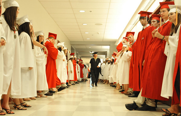 Boxford: Masconomet High School class of 2010 advisor and Spanish teacher Don Pierce walks down the hall as the students prepare to enter the field house. photo by Mark Teiwes / Salem News