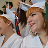 Salem: Sarah Dionne, left, and Christeena Decker beam as they line up with the Salem Academy Charter School's class of 2011 before a graduation ceremony at the Salem Waterfront Hotel.  photo by Mark Teiwes / Salem News